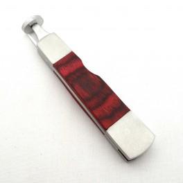 Outil pipe métal et bois rouge forme couteau